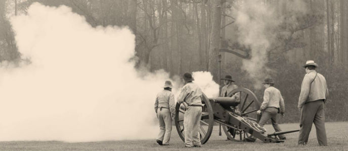 Living historians demonstrate firing a cannon