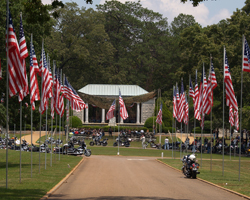 American Flags lining a road to a memorial structure
