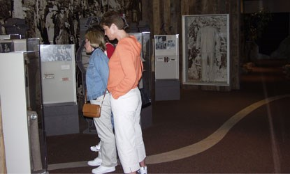 Visitors browse museum exhibits