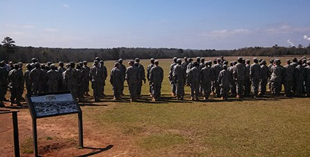 JROTC Cadets stand in uniform on the prison site