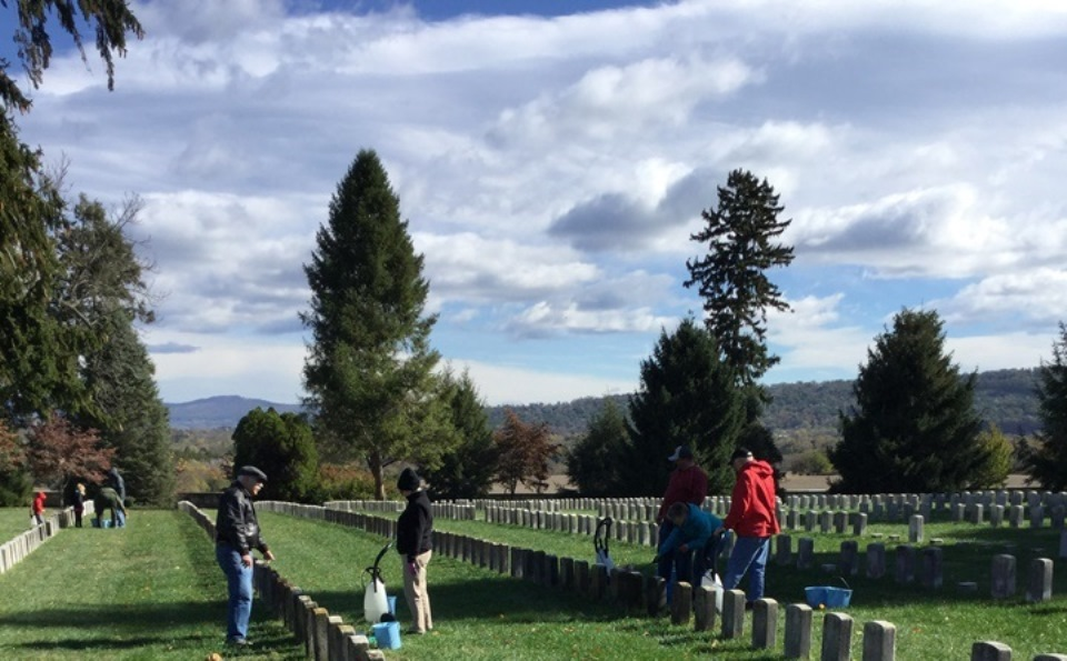 Volunteers cleaning headstones in Antietam National Cemetery.