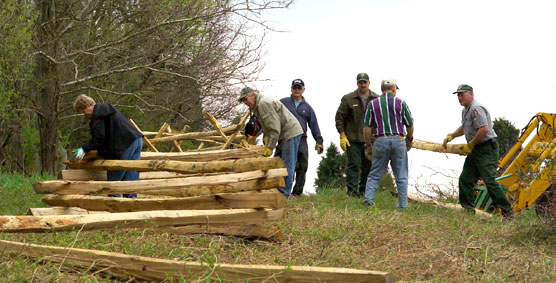 Volunteers and staff build historic fencing along the Otto Farm lane