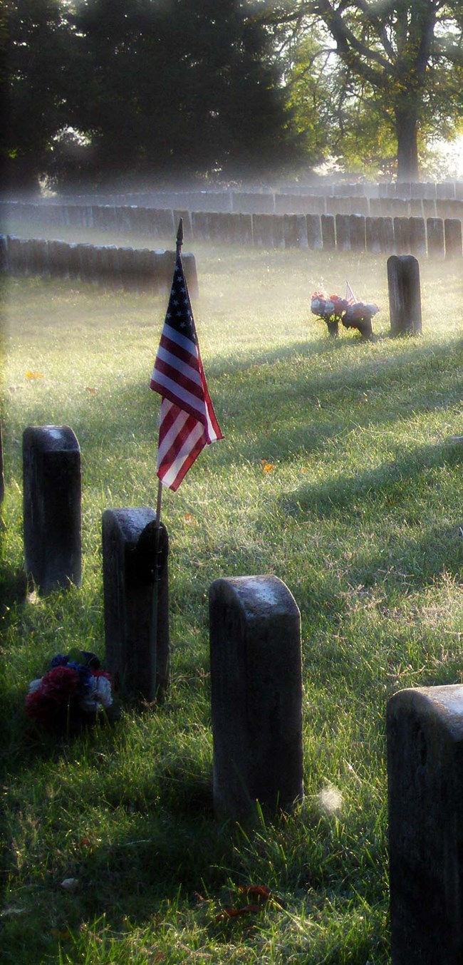flag on a foggy placed on a grave