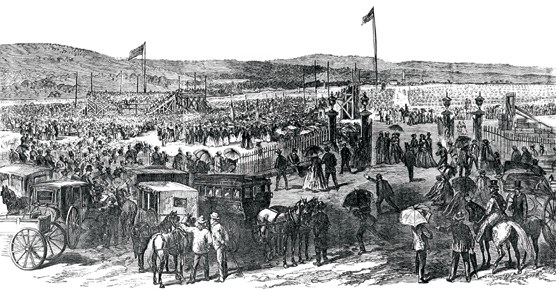 An engraving of a large crowd of men, women, horses, and carriages at the cemetery grounds.