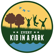 Logo shows children outside in nature