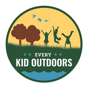 Every Kid Outdoors logo with children playing and doing cartwheels