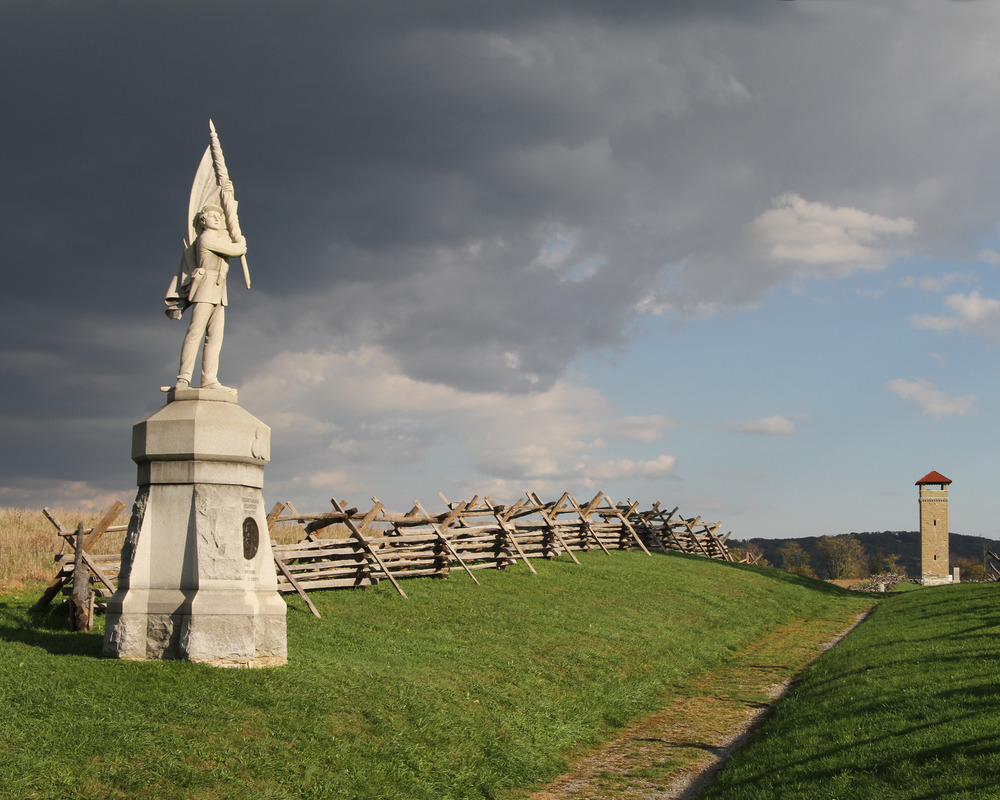 Dark clouds move in over Bloody Lane at Antietam with the 132nd Pennsylvania Infantry monument in the foreground.