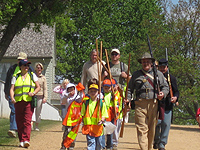 Cub Scouts prepare to pick up trash in the park.