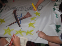 Children making a regimental flag during a summer camp activity.