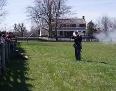 Ranger Bert Dunkerly demonstrates firing a gun for students.