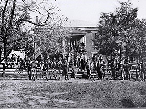 Photograph of the courthouse with provost guards (Federal soldiers) and village residents, late summer 1865.