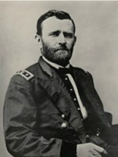 black and white photograph of a white man in a military uniform with his hair neatly combed he also has a trimmed full beard and a mustache