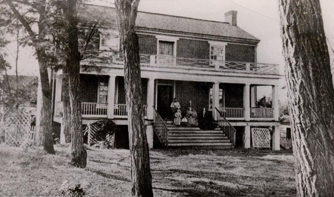 Picture of the McLean family sitting in front of the McLean House