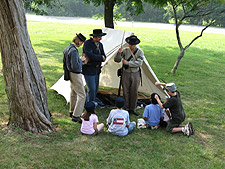 Day campers learn about soldiers' life during the Civil War.