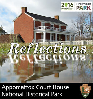McLean House reflection in a puddle after a rain storm