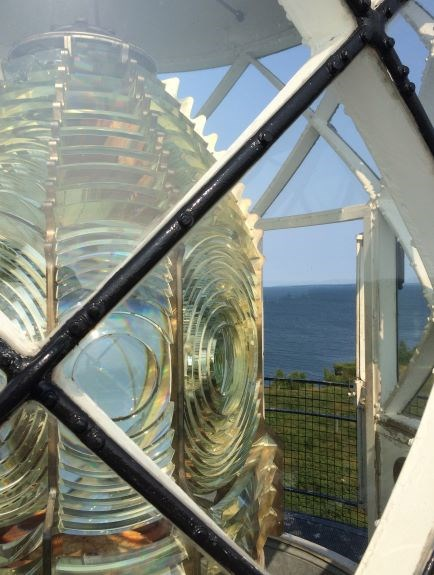 Looking at a fresnel lens through windows of the frame.