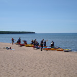 Kayakers at Meyers Beach prepare to launch for their visit to the Mainland Sea Caves.