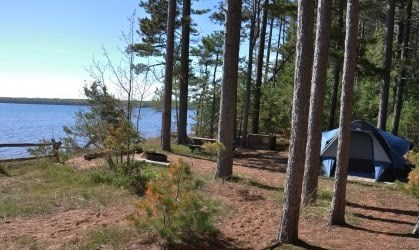 Tent among the red pines at campsite eleven on Stockton Island, overlooking Lake Superior.