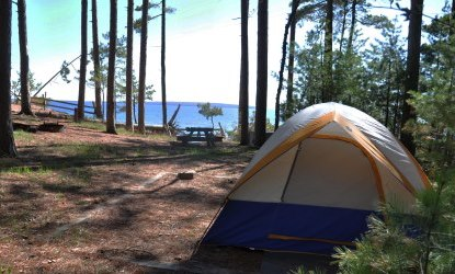 Tent on the tent pad at c&site twelve on Stockton Island with Lake Superior in & Stockton Island Campsites - Apostle Islands National Lakeshore ...