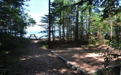 Tent pad and picnic table at Stockton Island campsite six, overlooking Lake Superior.