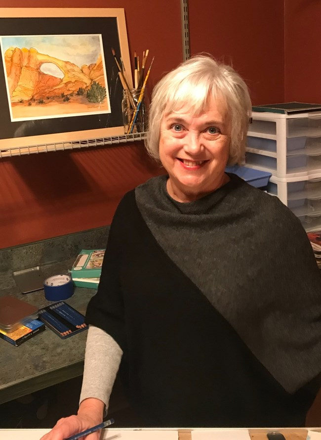 white-haired artist in her studio