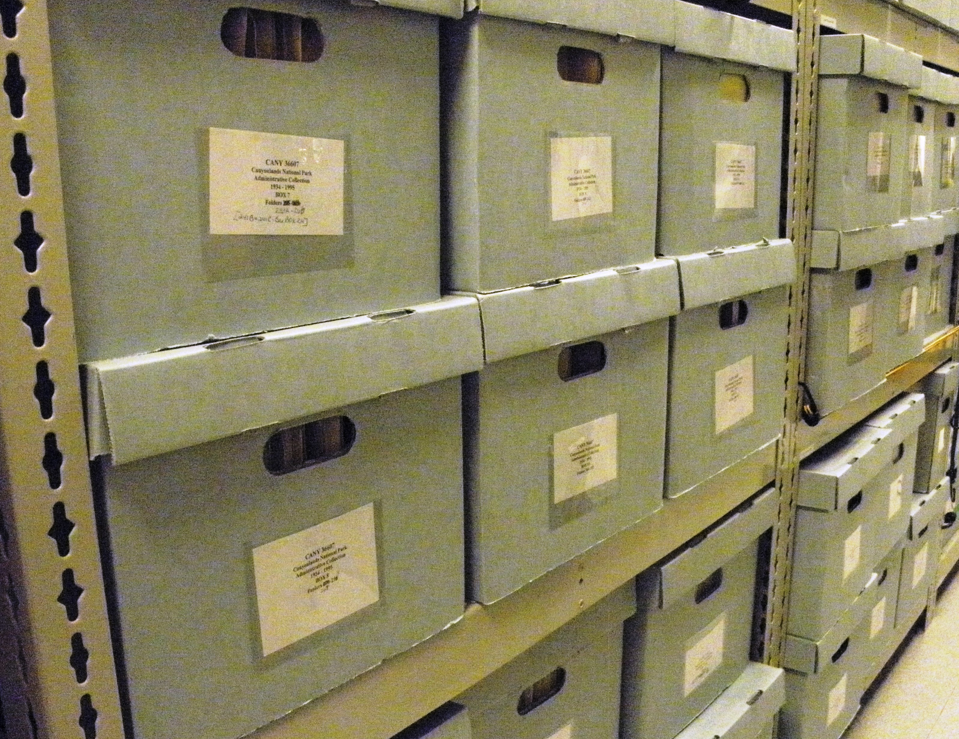 Photograph of archives boxes on archival shelving.