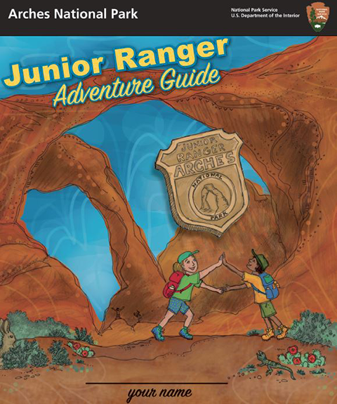 Cover drawing on the Arches Junior Ranger book shows two children stretching out their arms below Double Arch