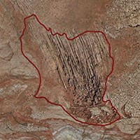 a satellite image of the Fiery Furnace area with a red line around it