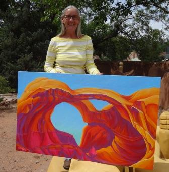 Serena Supple, 2014 CAIP, with painting of Double Arch