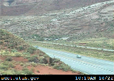 US Highway 191 with the Arches National Park entrance road in the background