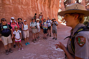 A ranger leading a hike in the Fiery Furnace.