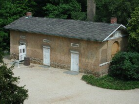 The Arlington House bookstore is in the west end of the north slave quarters behind the house.
