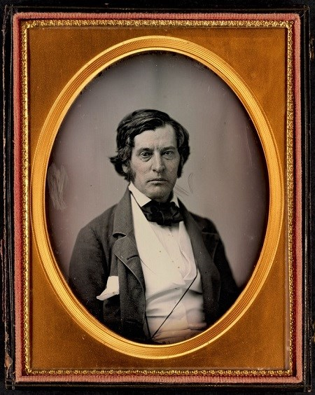 Portrait of Charles Sumner, a White man in a dark suit and white shirt.