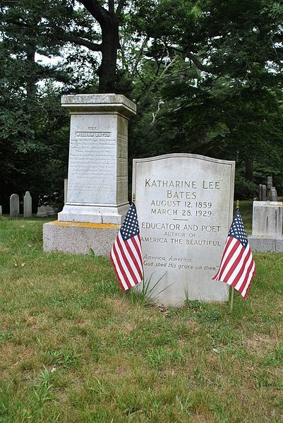 White headstone for Katherine Lee Bates flanked by American Flags