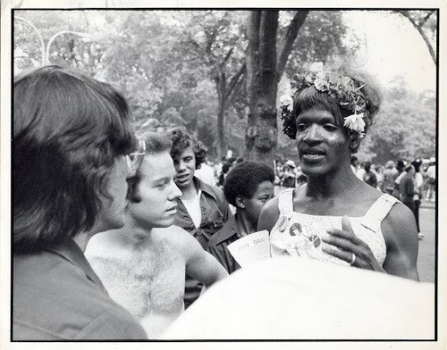 Marsha P. Johnson speaking with a group of people at a protest