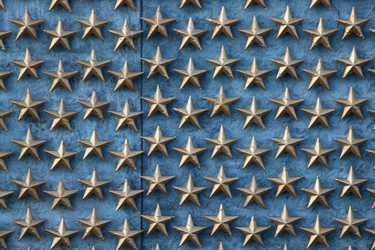 Gold stars on a blue wall