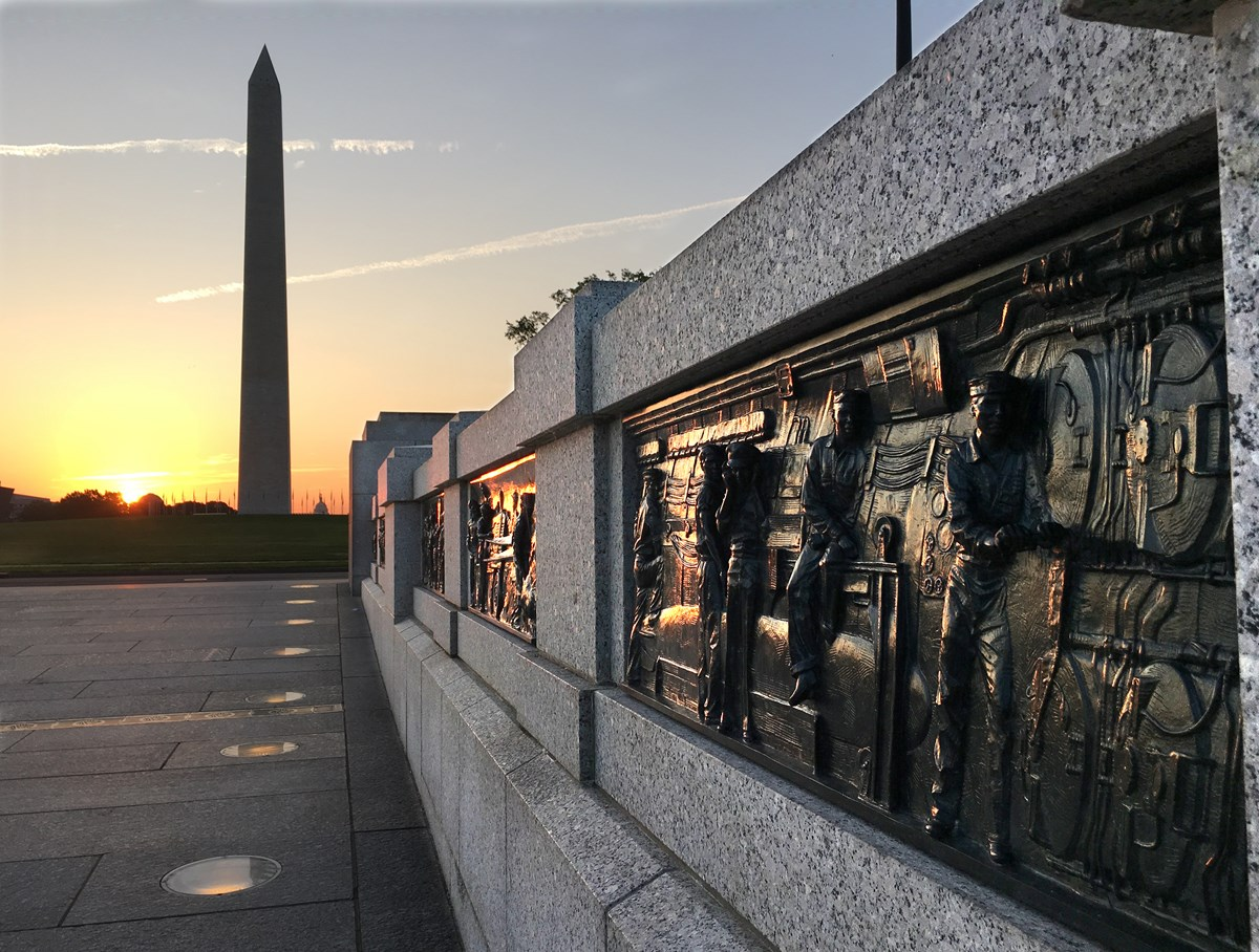 World War II reliefs and Washington Monument at sunrise