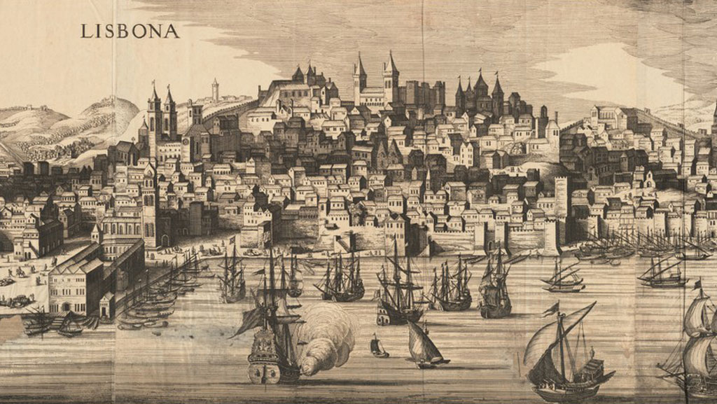 """Black and white print from an engraving of a dense city on a hillside. A wall with crenellations runs at the foot of the hill at the edge of the water in foreground. Docks are visible on the left side with a number of boats docked to them. Several ships in different sail configurations are sailing in the water. At the summit of the hill in the background appear a number of round towers, a castle, and a few cathedrals with square bell towers. On top left reads a label """"Lisbona""""."""