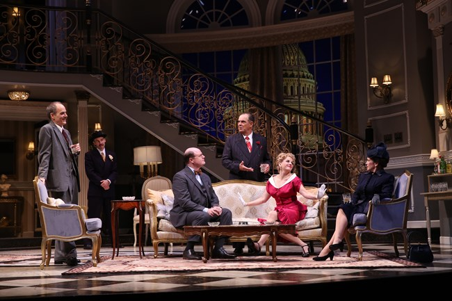 Actors in a living room set on stage