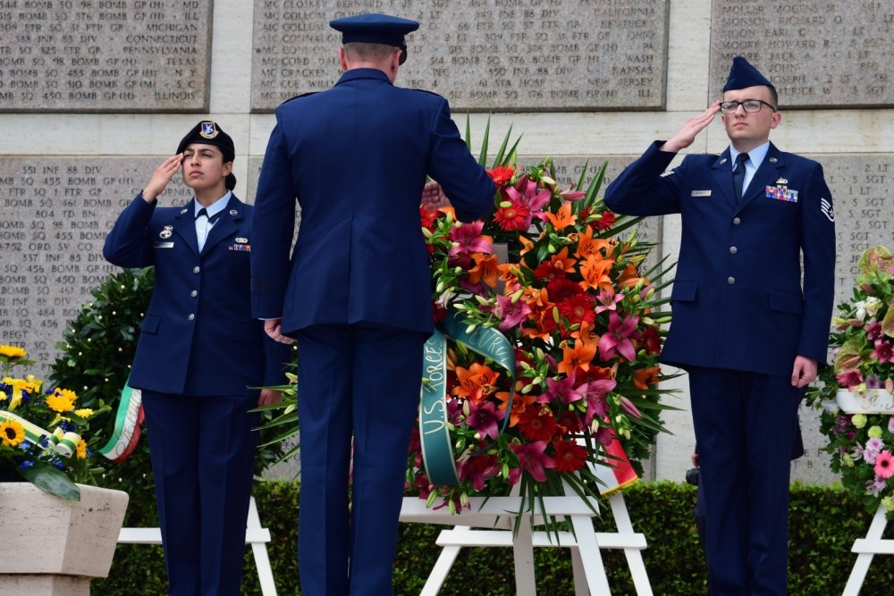 Soldiers saluting at a wreath laying ceremony
