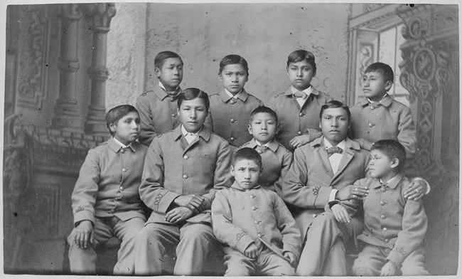 Group of boys in cadet uniforms as the carlisle indian school
