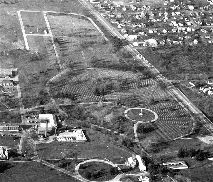 Aerial view of of a cemetery with monument in the middle.