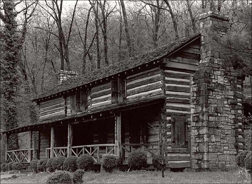 Two-story log cabin.