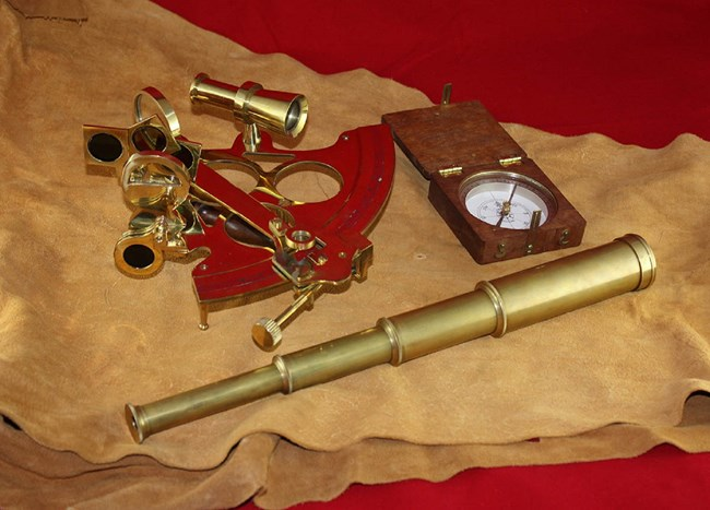 Sextant, pocket compass, and telescope
