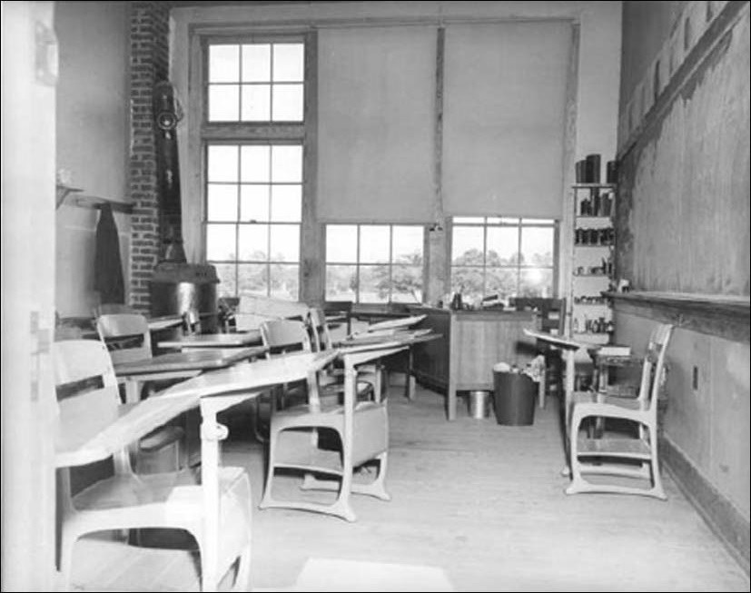 Photo of interior of classroom with desks and chalkboard. (Courtesy of the National Archives and Records Administration)