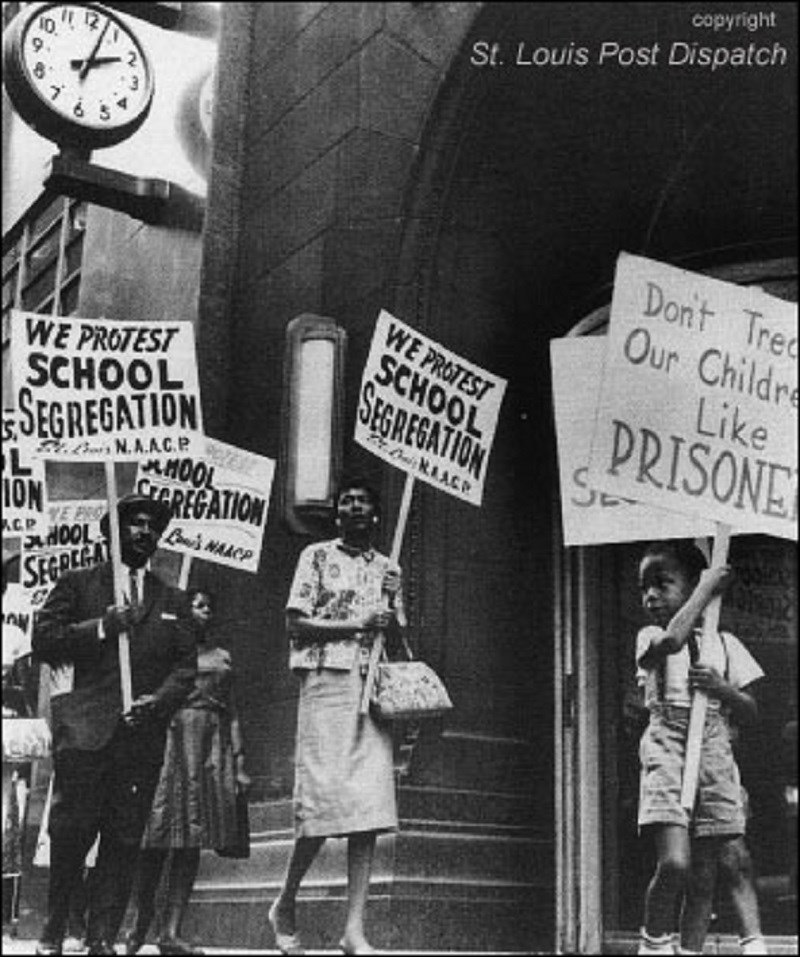 People holding signs protesting school segregation. (Courtesy of the St. Louis Post Dispatch)
