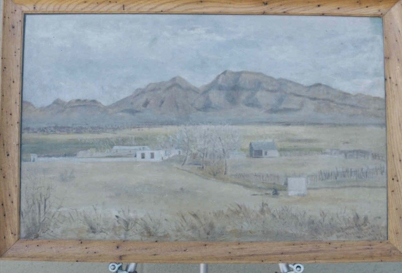 Painting of a western landscape.
