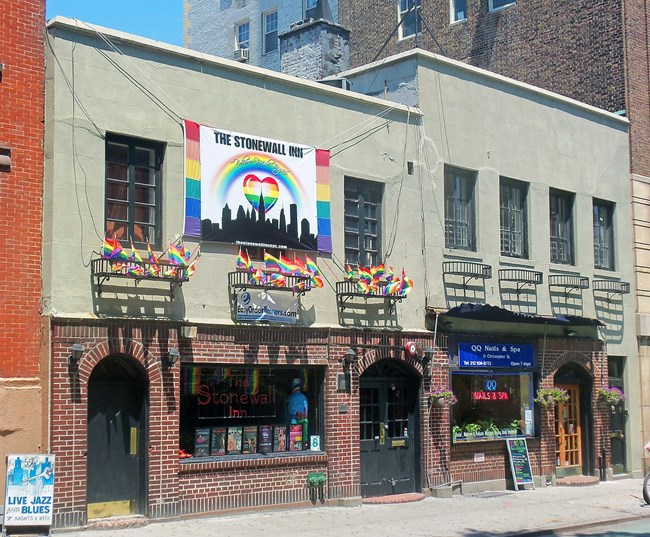 Exterior of the Stonewall Inn with Rainbow flags