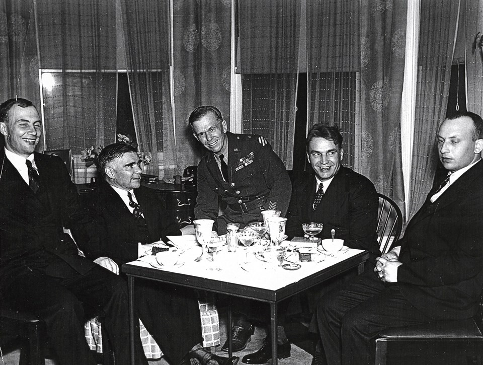 Photo of men seated at table