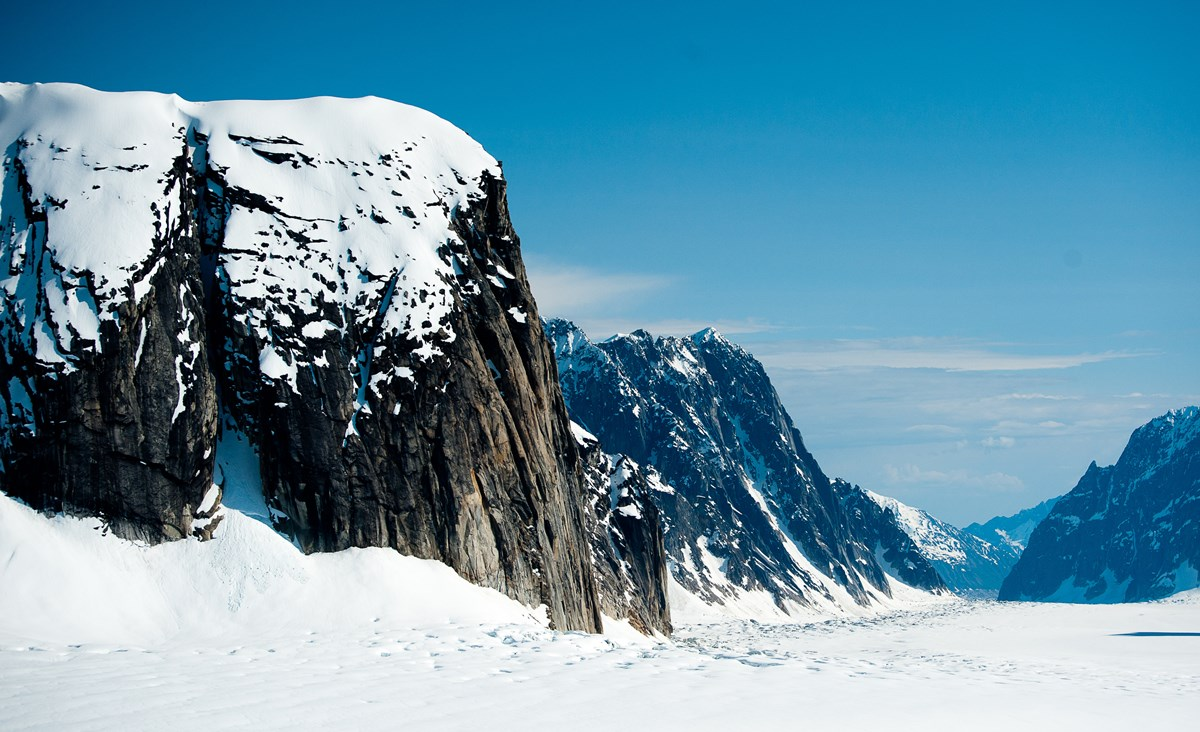 mountains towering over a glacier